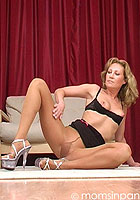 Sexy mom in pantyhose and black lingerie