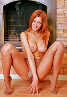 Busty redhead nude Elle in pantyhose