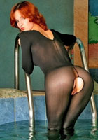 Kyra in sheer black bodystocking