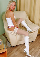 Nikita in white stockings, corset and boots